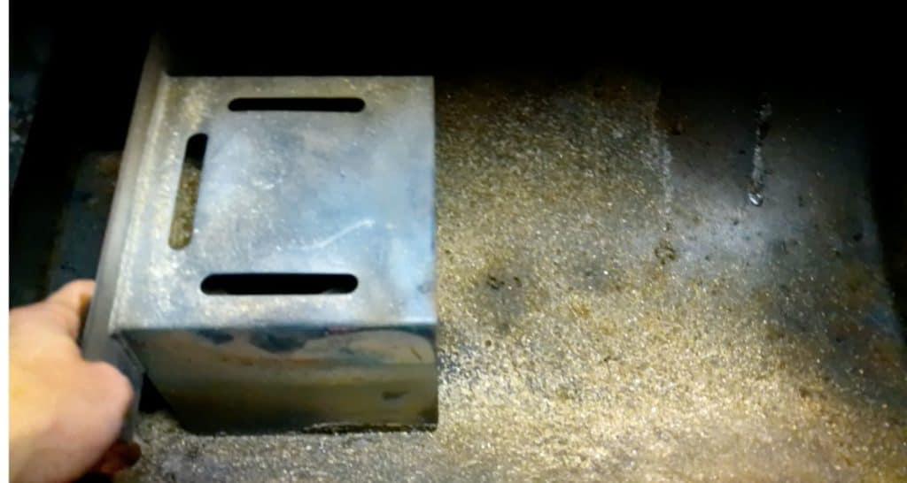 Slide Heat Baffle over to reveal firepot