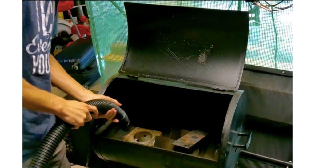 vacuum inside of firepot of traeger pellet grill