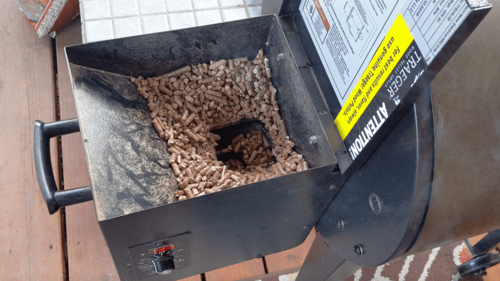 Traeger hopper with wood pellets tunneling